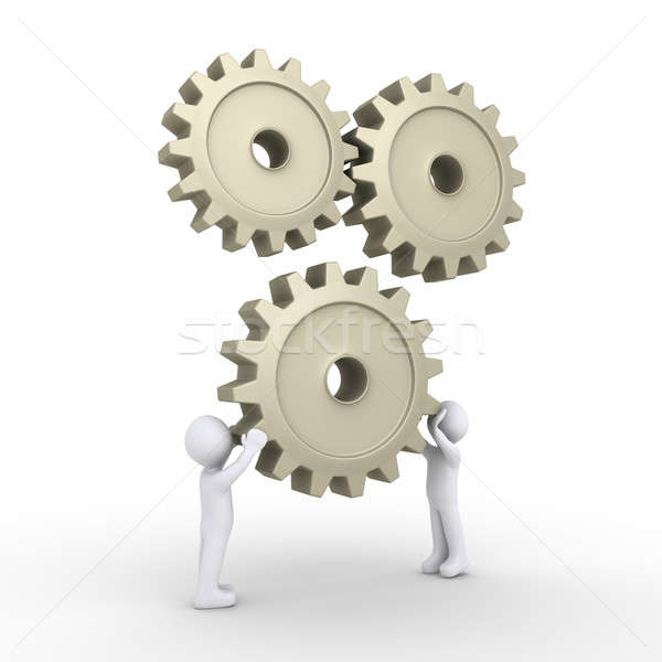Stock photo: Two persons attach cogwheel