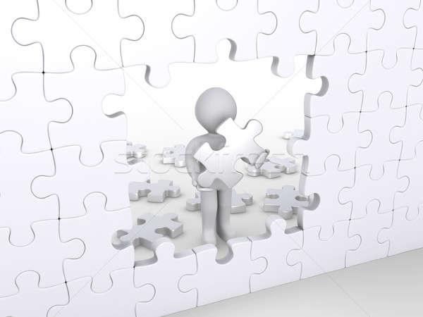 Person holding puzzle piece about to complete vertical puzzle Stock photo © 6kor3dos