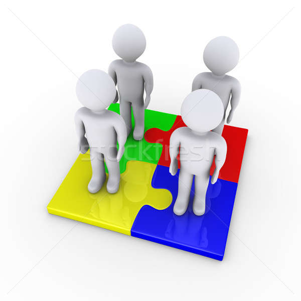 Four people on puzzle pieces provide solution Stock photo © 6kor3dos