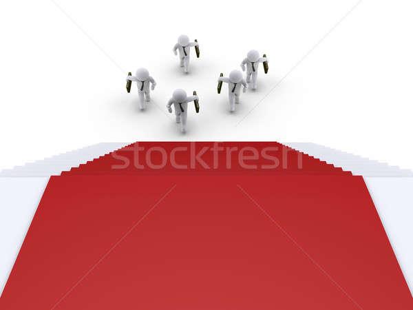 Stock photo: Businessmen are running towards stairs