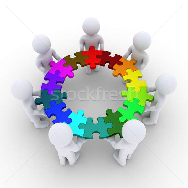 People holding puzzle pieces connected in a circle Stock photo © 6kor3dos