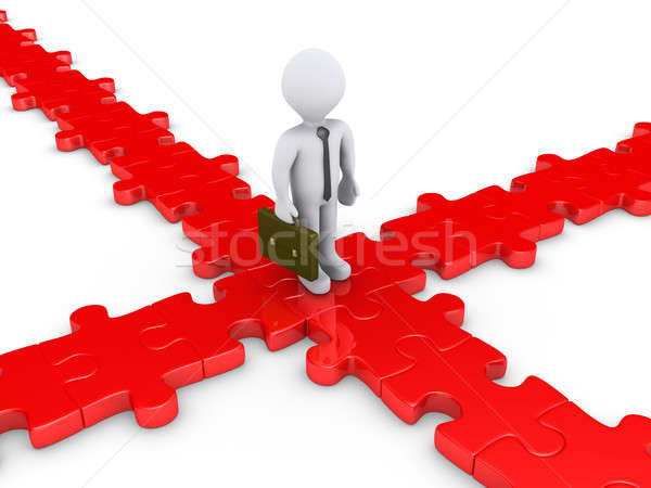 Businessman on puzzle pieces wondering for the right path Stock photo © 6kor3dos