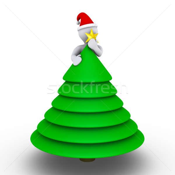 Placing the star on the Christmas tree Stock photo © 6kor3dos