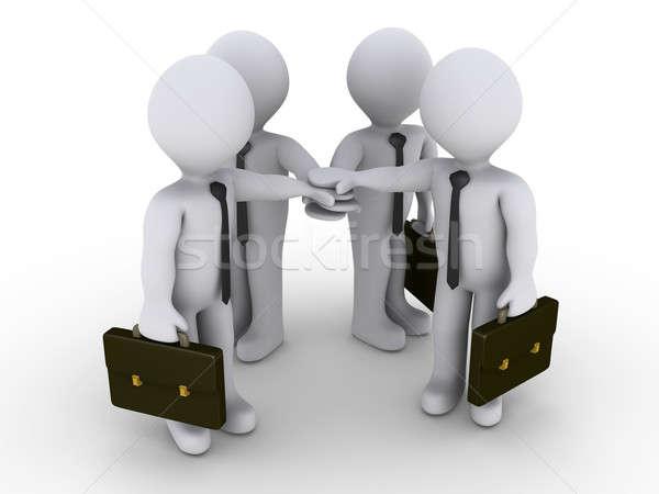 Four businessmen join hands Stock photo © 6kor3dos