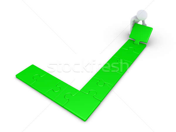 Person finishing a check mark puzzle Stock photo © 6kor3dos