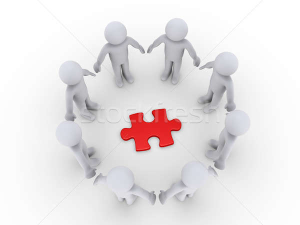 Stock photo: People in a circle around a puzzle piece