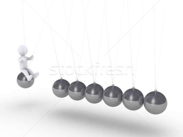 Person sitting on sphere of Newton's cradle Stock photo © 6kor3dos