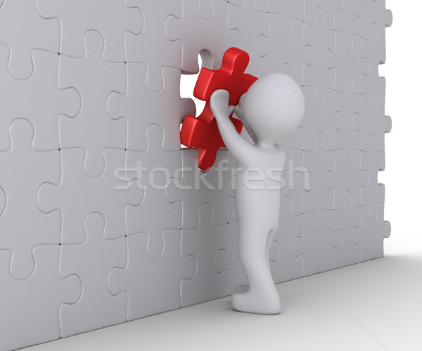 Person is completing wall puzzle Stock photo © 6kor3dos