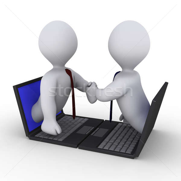 Businessmen handshake through laptop Stock photo © 6kor3dos