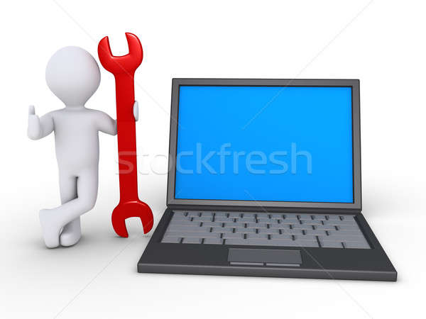 Person is holding wrench beside a computer Stock photo © 6kor3dos