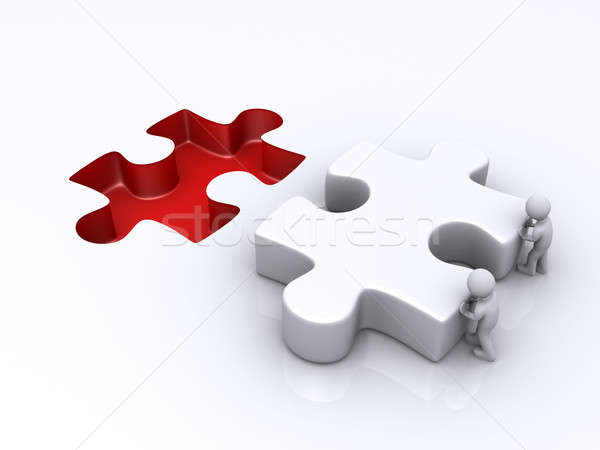 Two persons are pushing last puzzle piece Stock photo © 6kor3dos
