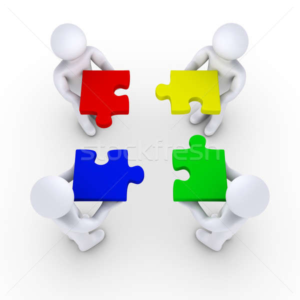 Four people holding puzzle pieces Stock photo © 6kor3dos