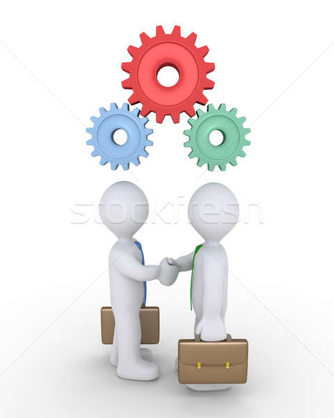 Businessmen joined with cogs Stock photo © 6kor3dos