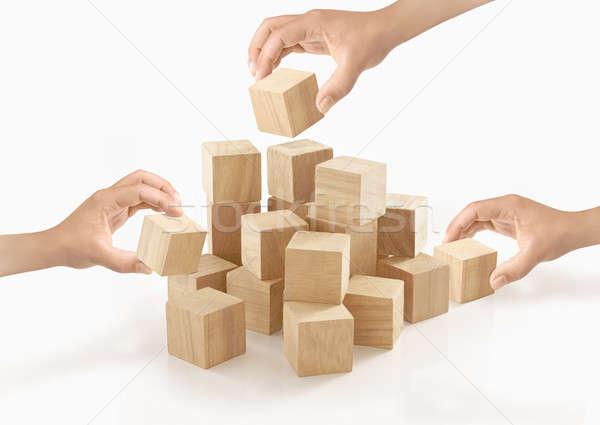 Veel handen spelen houten vak geïsoleerd Stockfoto © 7Crafts
