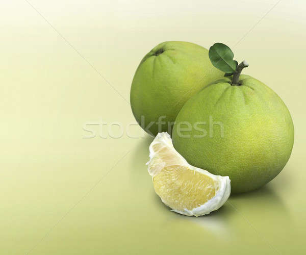 Pomelo on green solid background Stock photo © 7Crafts