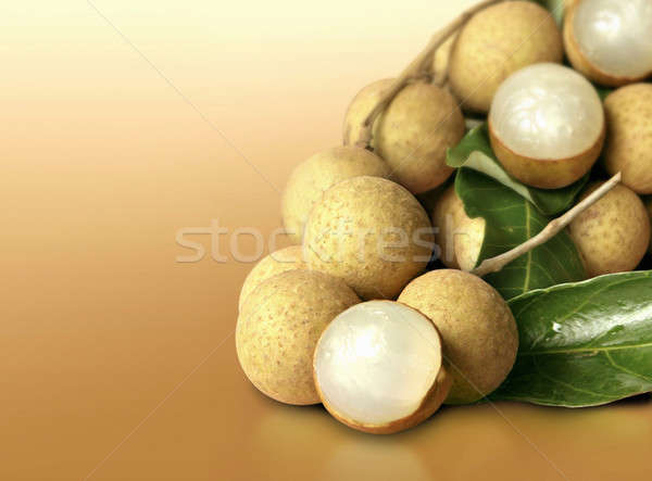 Longan on orange solid background Stock photo © 7Crafts