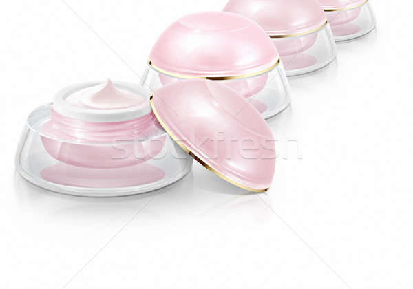 Several pink dome cosmetic jar on white background Stock photo © 7Crafts