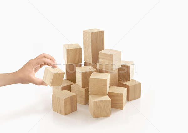 Single hand playing wooden box on isolated background. Stock photo © 7Crafts