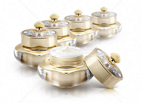 Several golden crown cosmetic jar on white background Stock photo © 7Crafts