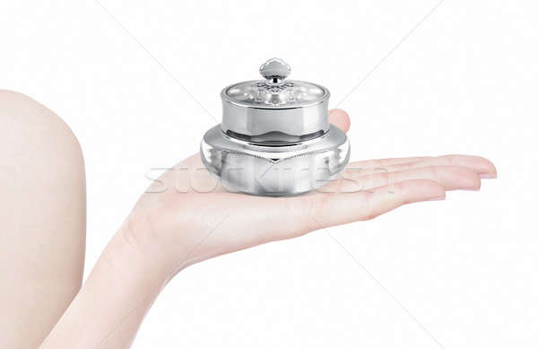 Silver deluxe cosmetic jar on hand isolated Stock photo © 7Crafts