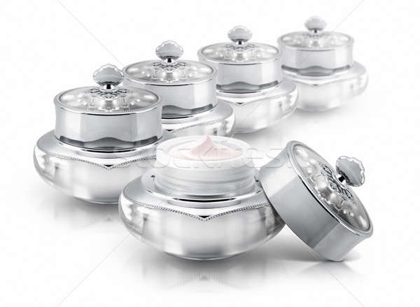 Stock photo: Several silver deluxe cosmetic jar on white background