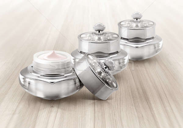 Silver deluxe cosmetic jar on wood background Stock photo © 7Crafts