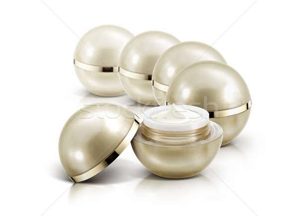 Birkaç altın küre kozmetik kavanoz beyaz Stok fotoğraf © 7Crafts