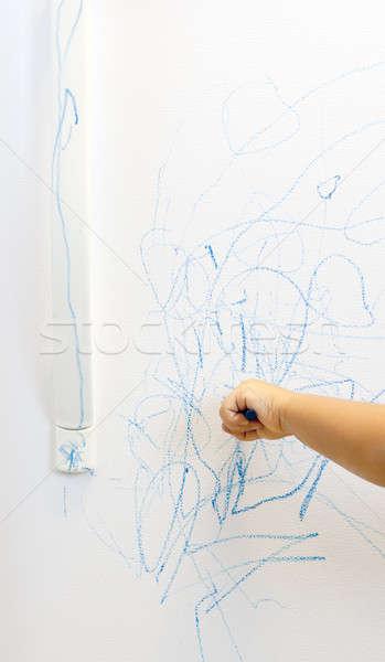 child hand scribbling on fridge Stock photo © 808isgreat