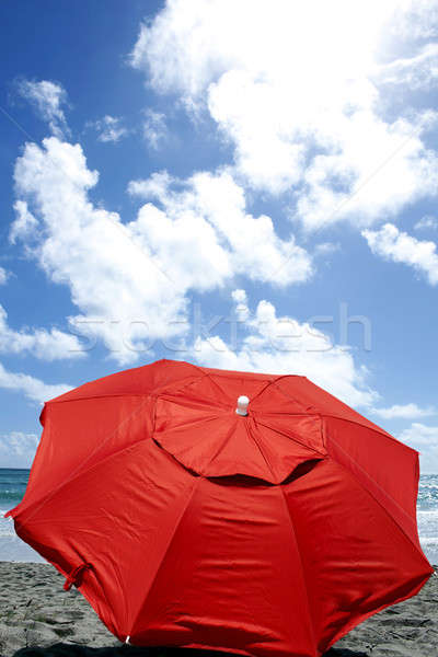 red umbrella at beach - front view Stock photo © 808isgreat