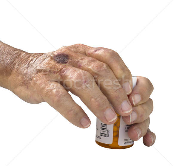 Elderly male hand with arthritis holding pills Stock photo © 808isgreat