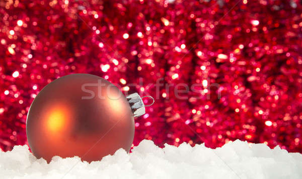 red christmas ornament in a pile of snow - ice Stock photo © 808isgreat