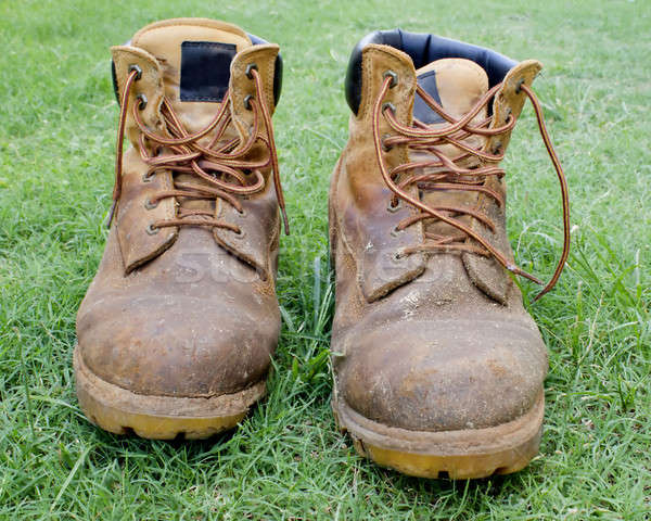 A pair of tan work boots on grass Stock photo © 808isgreat