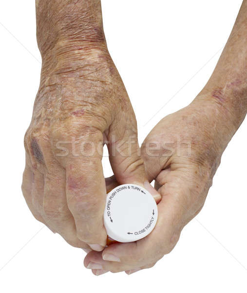 Male hand arthritis holding pills - with clipping path Stock photo © 808isgreat