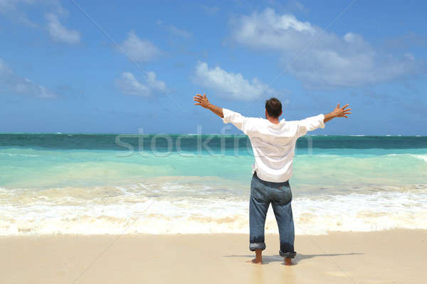single male standing on beach facing ocean open arms Stock photo © 808isgreat