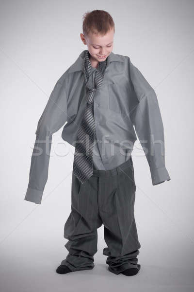 Stock photo: Boy in big shirt and pants