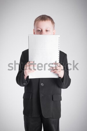 Boy presses the stack of paper Stock photo © a2bb5s