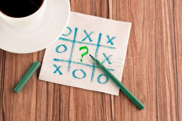 Tick-tack-toe and question mark on a napkin Stock photo © a2bb5s