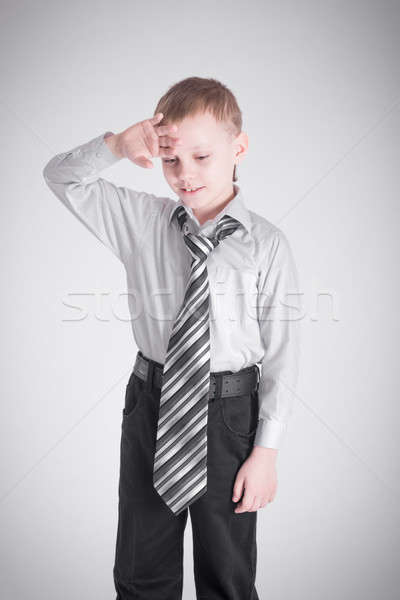 Boy holding his hand to his forehead Stock photo © a2bb5s