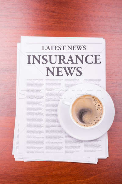 The newspaper INSURANCE NEWS and coffee Stock photo © a2bb5s