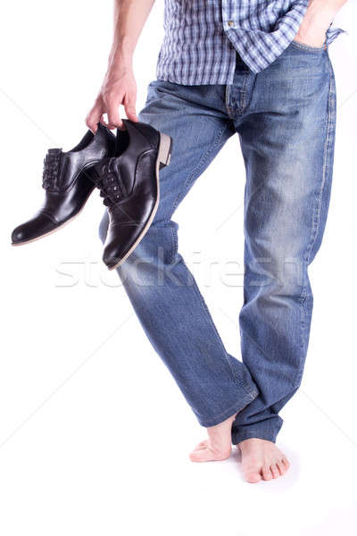 Men's holding a pair shoes Stock photo © a2bb5s