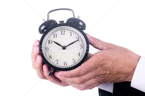 Hands of men holding alarm clock Stock photo © a2bb5s