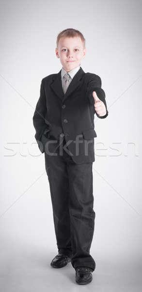 Garçon geste costume noir affaires noir jeunes Photo stock © a2bb5s