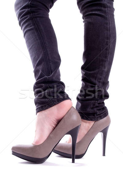 The woman removes her shoe Stock photo © a2bb5s