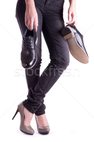Woman holding a pair of men's shoes Stock photo © a2bb5s