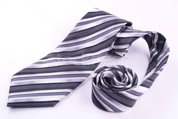 Stock photo: Tie rolled into a spiral