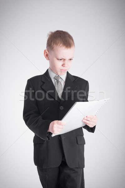 Garçon papiers costume noir affaires Photo stock © a2bb5s