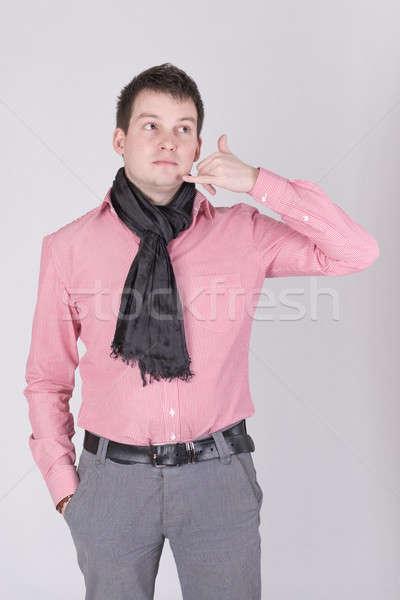 Adam imzalamak telefon kırmızı gömlek Stok fotoğraf © a2bb5s