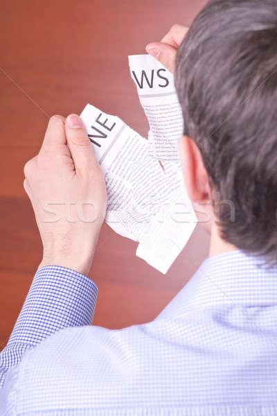 Man tore newspaper Stock photo © a2bb5s