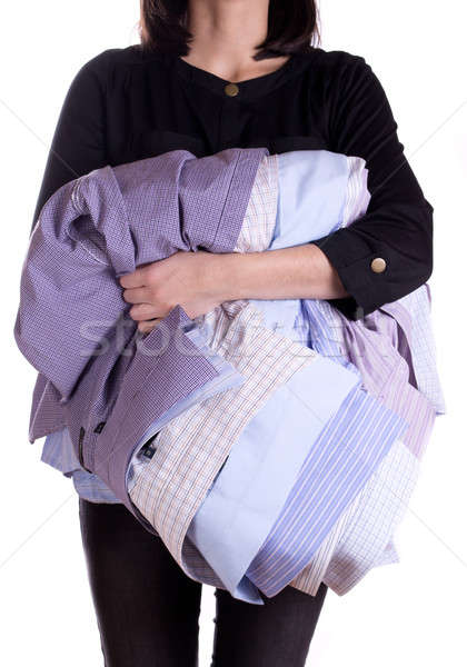 Woman holding shirt in hand Stock photo © a2bb5s