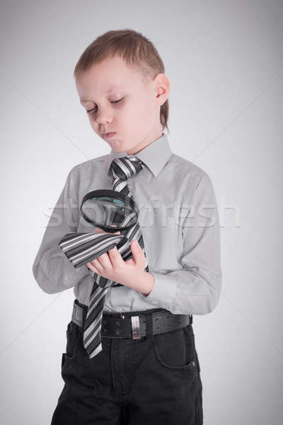 Boy studying his tie Stock photo © a2bb5s